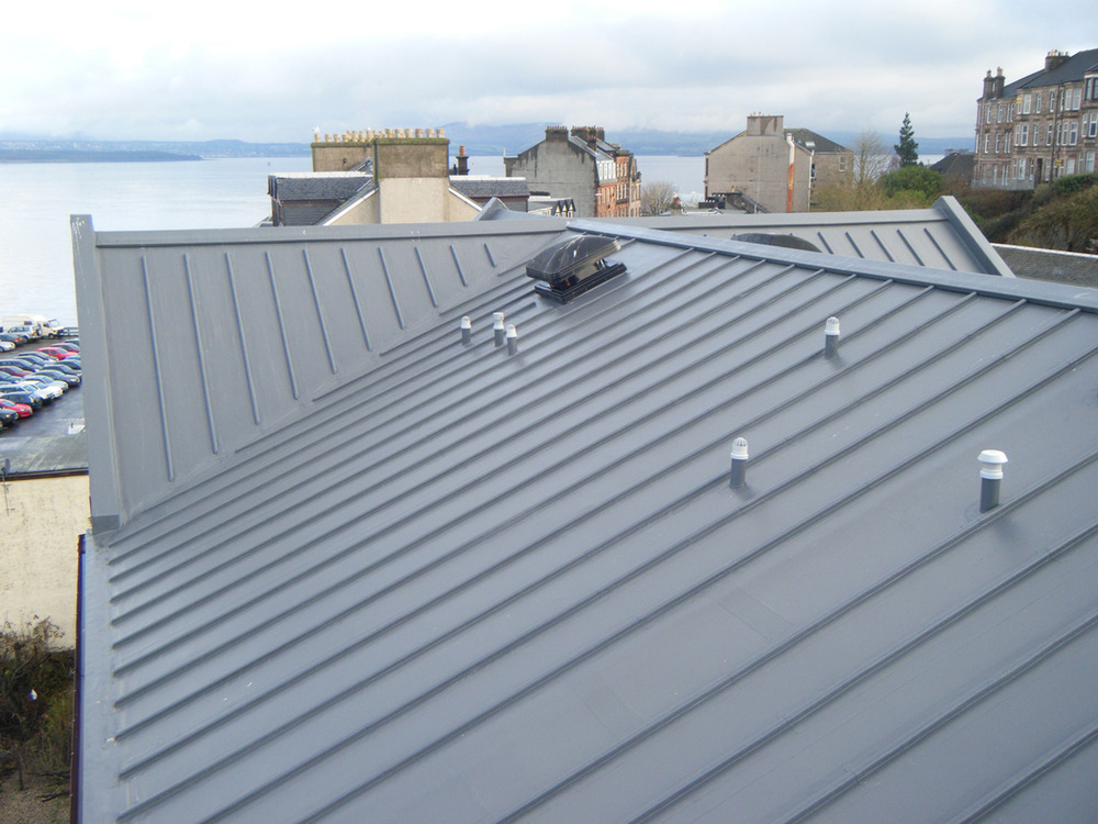 Wind-battered building's costly insurance claims for roof ...