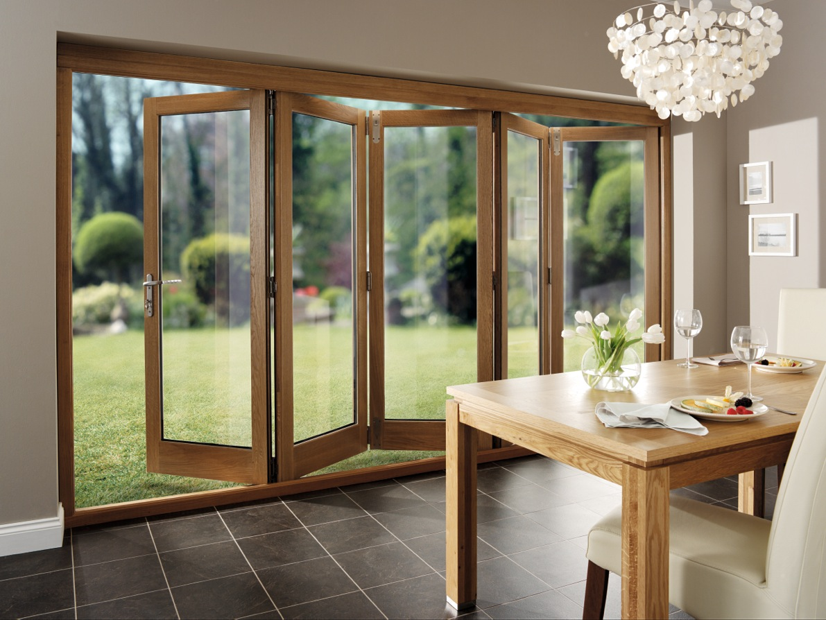 Folding doors folding doors oak for Glass patio doors