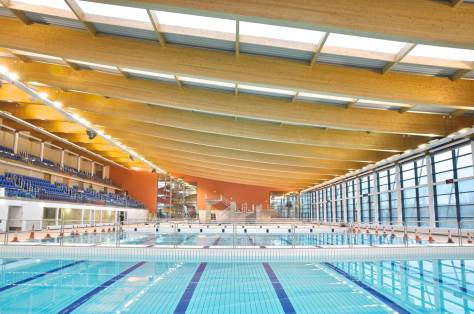 Bangor Aurora Aquatic & Leisure Complex, Northern Ireland, was designed by McAdam Design with PEFC spruce softwood glulam beams from Austrian timber engineers Weihag GmbH. With a roof area of 11,480m2 and containing over 1,500m3 of glulam timber, by volume of timber this is currently the largest timber roof structure in the UK. The project achieved a BREEAM Excellent rating.