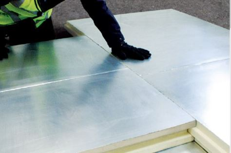The thermal insulation is applied with specialist FIA adhesive to the prepared roof deck