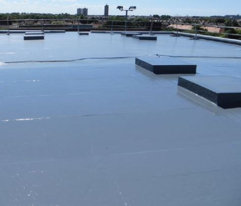 The Elastaseal top coat is being applied to the roof deck.