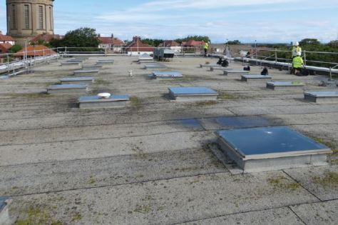 the condition of the roof and significant number of roof mounted lights, which the new roofing system needed to incorporate