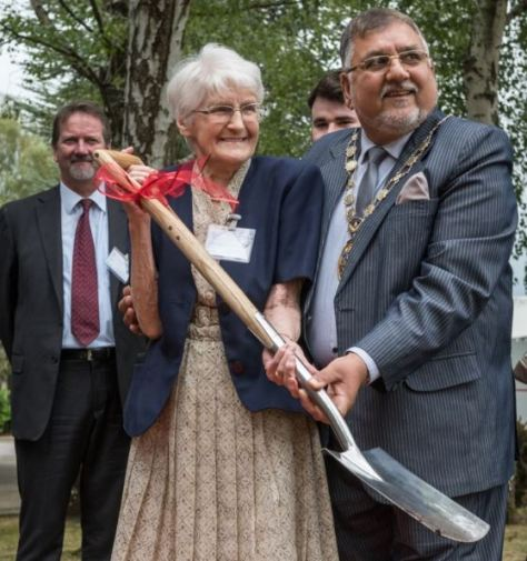 91-Year-old former employee Edna Barnett helps The Mayor of Crawley, Councillor Raj Sharma, bury Vent-Axia's time